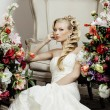 Beauty young bride alone in luxury vintage interior with a lot o — Stock Photo #62483111