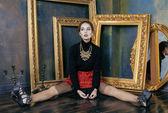 Beauty rich brunette woman in luxury interior near empty frames, — Stock Photo