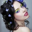 Beauty young woman with flowers and make up close up, real sprin — Stock Photo #63148821