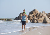 Happy family on beach playing, father with son walking sea coast — Foto Stock
