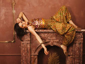 Beauty sensual young woman  oriental style in luxury room — Stock Photo