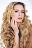 Beauty blond woman with long curly hair close up isolated, hairs — Stock Photo