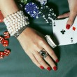 Woman with bright manicure at casino table — Stock Photo #64844963