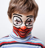 Boy with clown face paint — Stock Photo