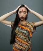 Girl with make up like Pocahontas — Stock Photo