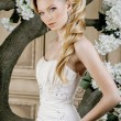 Beauty young bride alone in luxury vintage interior with a lot o — Stock Photo #67887419