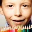Little cute boy with color pencils close up smiling, education f — Stock Photo #68482121