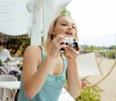 Young cute teenage girl with camera outside, adorable photograph — Stock Photo