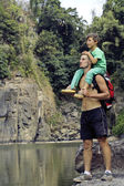 Father and son making a trip to waterfall together, happy family — Foto Stock