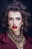 Beauty rich brunette woman with a lot of jewellery, hispanic cur — Stock Photo