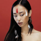 Beauty young asian girl with make up like Pocahontas, red indian — Stock Photo