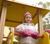 Little cute girl playing outside on playground — Stock Photo