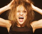 Crazy funny goofy girl with messed hair close up — Stock Photo