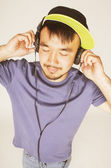 Young asian man in hat and headphones — Stock Photo