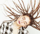 Real caucasian woman with dreadlocks hairstyle funny cheerful faces on white — Stock Photo
