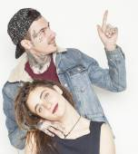 Young couple together. guy with tattoo, girlfriend wearing dreadlocks — Stock Photo