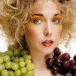 Beautiful young woman portrait excited smile with fantasy art hair makeup style, fashion girl creative food fruit orange, grapes, citrus make up, happy looking at camera isolated — Stock Photo #79306376