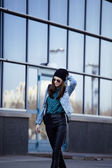 Young pretty girl near business building walking — Stock Photo