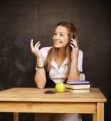Young pretty girl student in classroom at blackboard — Stock Photo