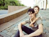 Little son with father in city hagging and smiling, casual look — Stock Photo
