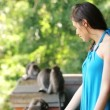 Woman in monkey forest in Ubud — Stock Video #59347405