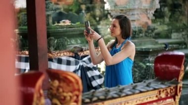 Woman taking photo of ancient temple — Stock Video