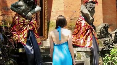 Woman looking at sculptures in temple — Stock Video