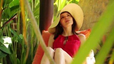 Woman drinking cocktail in gazebo — Stock Video