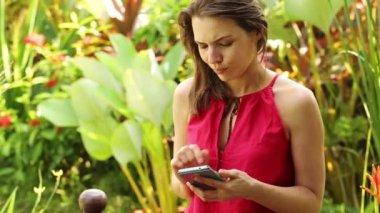 Impatient woman waiting in garden — Stock Video