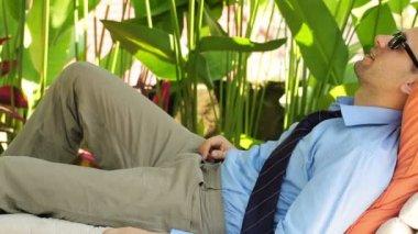 Businessman resting at luxury gazebo — Stock Video