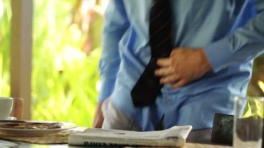 Businessman with tea and newspaper — Stock Video