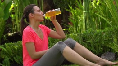 Woman drinking isotonic drink after workout — Stock Video