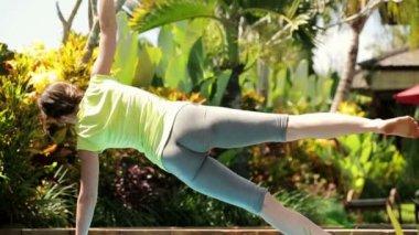 Woman exercising in the garden — Stock Video
