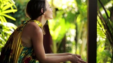Cheerful woman sitting on bench — Stock Video