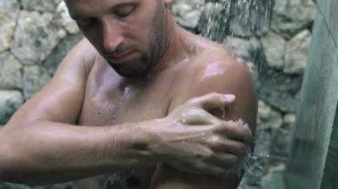Man washing his body under shower — Stock Video