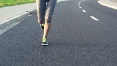 Woman jogging on asphalt road — Stock Video