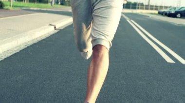 Jogger running on asphalt road — Stock Video