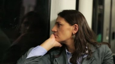 Pensive, sad businesswoman riding metro train — Stockvideo