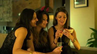 Cheerful girlfriends taking photo with cellphone during party — Stock Video