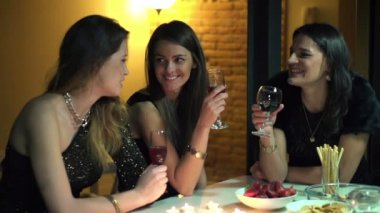Elegant girlfriends chatting by the table at night party, slow motion — Stock Video