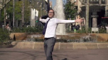 Happy successful businessman turning round in the city — Stock Video