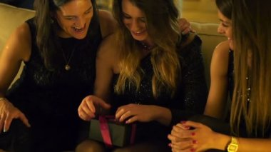 Woman gets gift from her girlfriends on hen party, slow motion — Stock Video