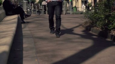 Man walking on pavement in the city, super slow motion, shot at 240fps — Stock Video