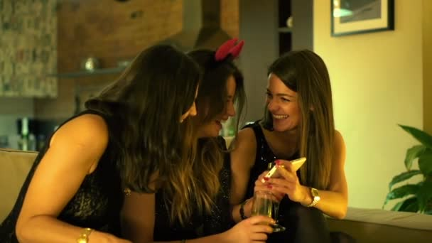 Cheerful elegant young girlfriends with smartphone during party — Vidéo