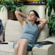 Young businesswoman relaxing on sofa after work at home — Stock Video #61866145