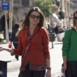 Girlfriends with shopping bags walking in the city — Stock Video #61866203