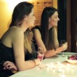 Elegant girlfriends looking at smartphone during party — Stock Video #61866439
