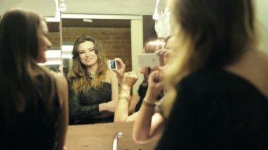 Elegant girlfriends taking selfie photo in bathroom before party — Stock Video
