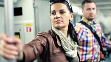Young woman riding metro train — Stock Video
