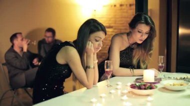 Unhappy, bored, sad girlfriends during party at home — Stock Video
